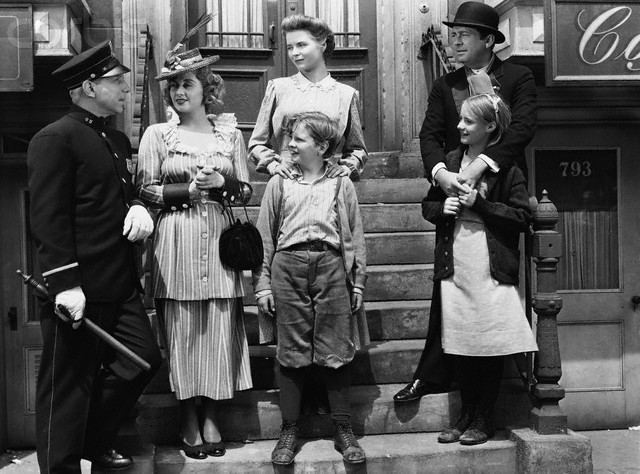 ca. 1945 --- Lloyd Nolan as Officer McShane, Joan Blondell Aunt Sissy Nolan, Dorothy McGuire as Katie Nolan, Ted Donaldson as Neeley Nolan, James Dunn as Johnny Nolan, and Peggy Ann Garner as Francie Nolan in the 1945 film A Tree Grows in Brooklyn. --- Image by © John Springer Collection/CORBIS